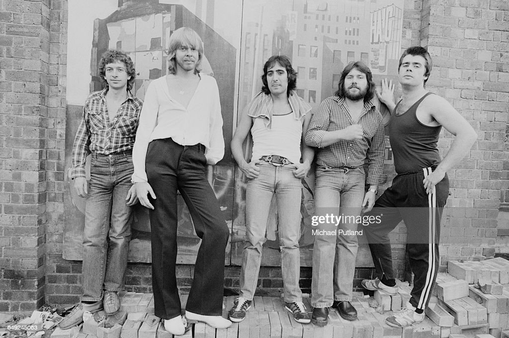 English composer and keyboard player Rick Wakeman and his band, August 1980. Left to right: guitarist Tim Stone, Wakeman, drummer Tony Fernandez, singer Ashley Holt and bassist Steve Barnacle.