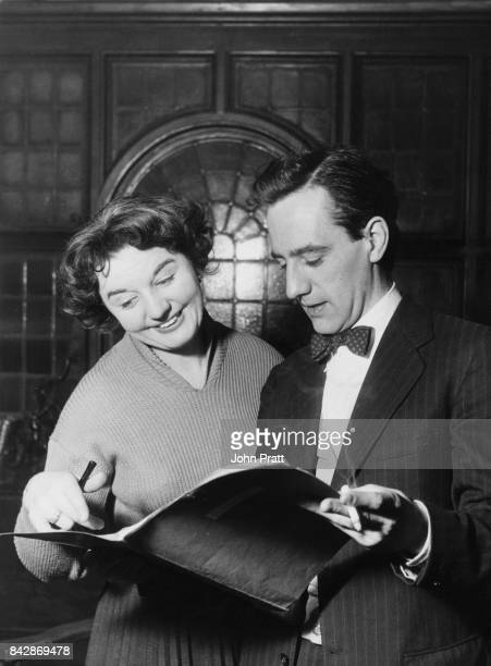 English composer and lyricist Sandy Wilson and actress and director Vida Hope go over the script for the stage musical 'The Boyfriend' January 1954...