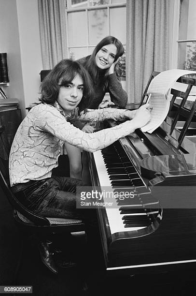 English composer Andrew Lloyd Webber with his fiancee Sarah Hugill at the piano UK 20th June 1971
