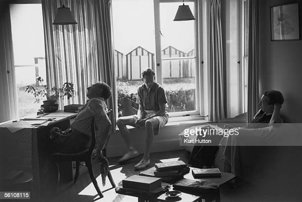 English composer Benjamin Britten at home in Aldeburgh Suffolk 15th October 1949 where he is working on his new opera 'Billy Budd with novelist EM...