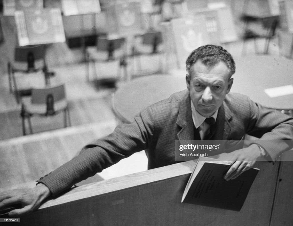 English composer Benjamin Britten (1913 - 1976) at the Royal Festival Hall, London, holding the score of his cantata 'Voices For Today'.