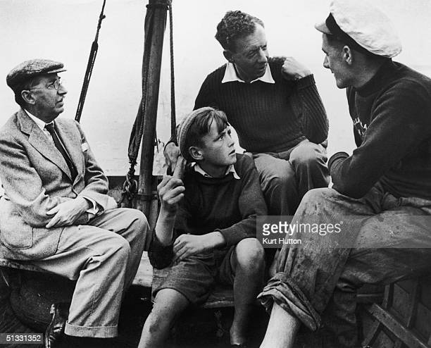 English composer Benjamin Britten goes boating in Aldeburgh with novelist Edward Morgan Forster and a couple of friends October 1949 Britten and...