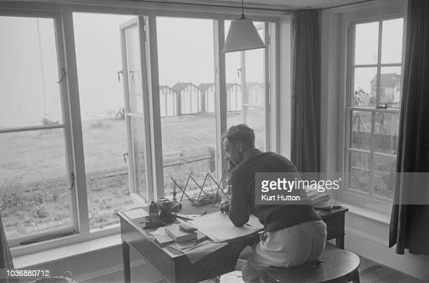 English composer Benjamin Britten working on his new opera 'Billy Budd' at his beachside home in Aldeburgh Suffolk October 1949 Original Publication...