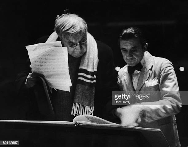 English composer, Ralph Vaughan-Williams , confers with British conductor Sir John Barbirolli over the score of Vaughan-Williams' 'Sinfonia...