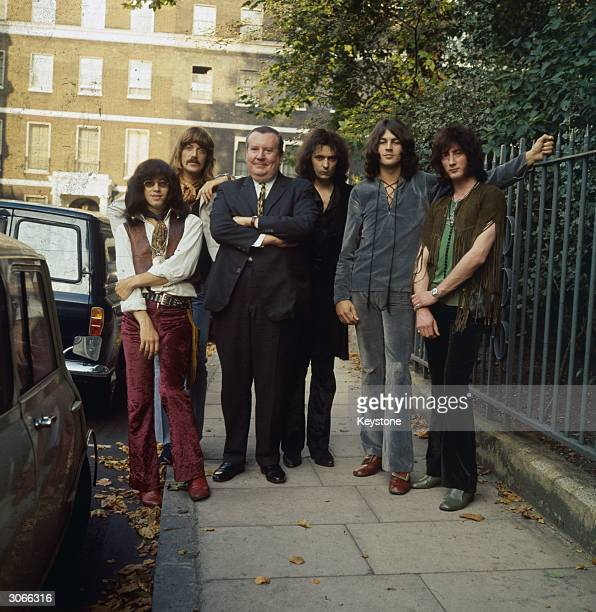 English composer Sir Malcolm Arnold poses with newly formed British heavy metal rock band Deep Purple From left to right are Ian Paice Jon Lord Sir...