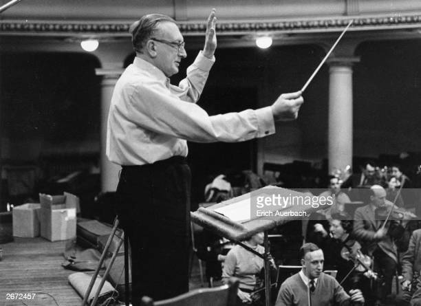 English composer Sir William Walton conducting the recording of his dramatic cantata 'Belshazzar's Feast' at Kingsway Hall, London.