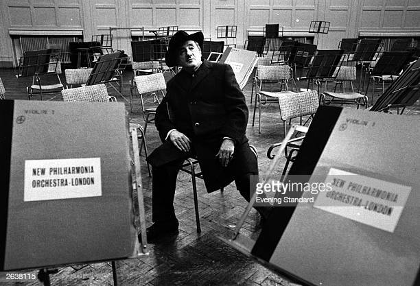 English conductor and cellist Sir John Barbirolli sits alone in the practice room of the London Philharmonic Orchestra.