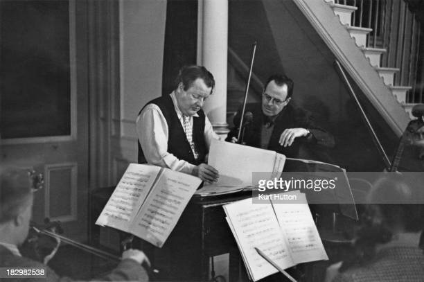 English conductor and composer Constant Lambert rehearsing the score to the ballet 'Ballabile' in the Grand Foyer of the Royal Opera House Covent...