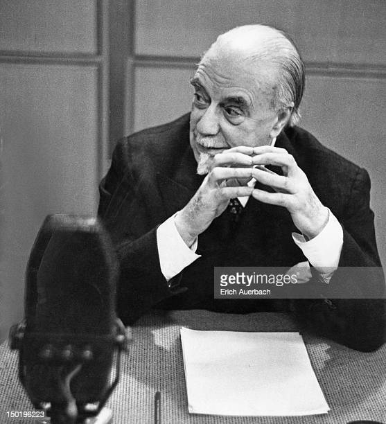English conductor and impresario Sir Thomas Beecham in a radio studio, where he is taking part in the BBC Home Service radio series 'Frankly...