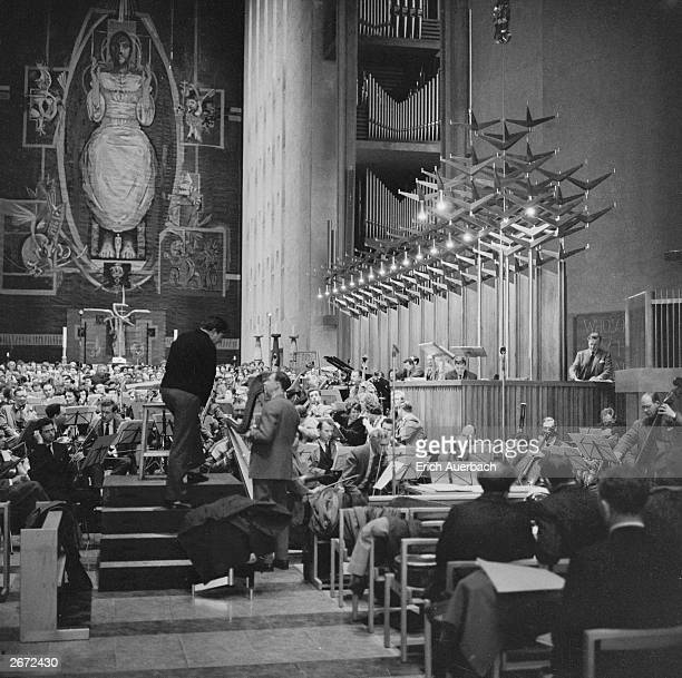 English conductor and organist Meredith Davies and English composer Benjamin Britten make preparations at Coventry Cathedral for the premiere of...