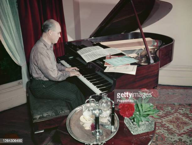 English conductor and violinist Hugo Rignold plays a piano at home in England in June 1952