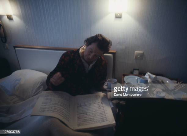English conductor and violinist Sir Neville Marriner working in bed circa 1975