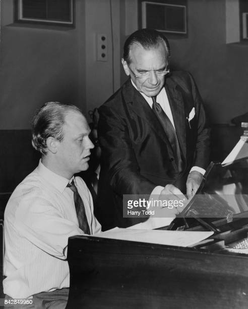 English conductor Sir Malcolm Sargent talks to pianist Robin Harrison before a rehearsal of Stravinsky's 'Petrouchka' at the Maida Vale Studio London...