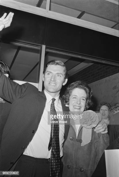 English Conservative Party politician Cecil Parkinson celebrates with his wife Ann after winning the Enfield West byelection in North London on 21st...