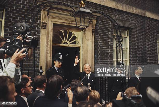 English Conservative party politician Edward Heath waves to supporters and members of the press outside his new official home Number 10 Downing...