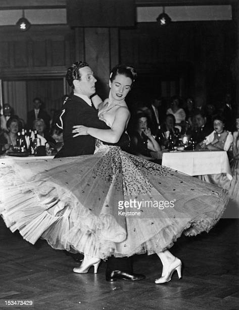 English contestants Jack McGregor and Miss B Twiggs win the first prize in the International Ballroom Dancing Competition at Bad Kissingen Germany...
