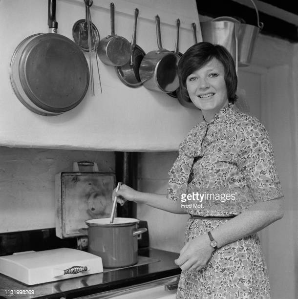 English cook and television presenter Delia Smith preparing food in a kitchen, UK, 19th August 1975.