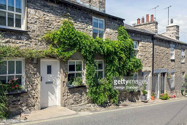 english cottage cumbria - stone material stock photos and pictures