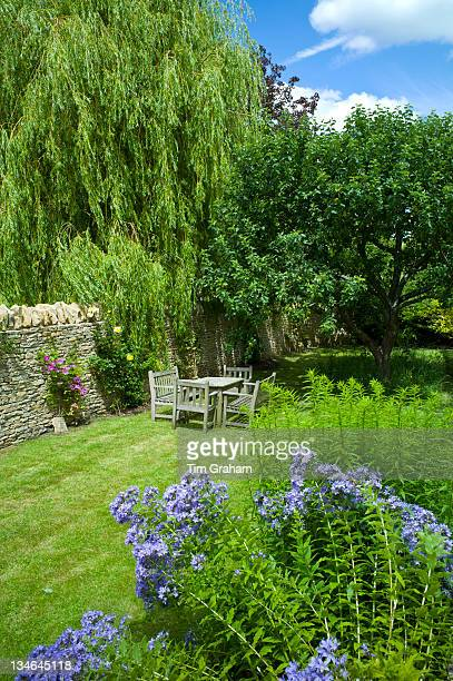 English cottage garden in Swinbrook in The Cotswolds Oxfordshire UK
