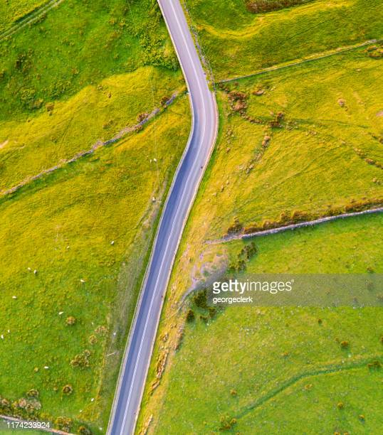english country road from directly above - farm stock pictures, royalty-free photos & images