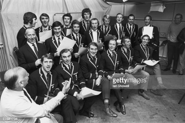 English cricket commentator Brian Johnston conducts the England cricket team in a rendition of 'The Ashes Song' at the Decca Recording Studios in...
