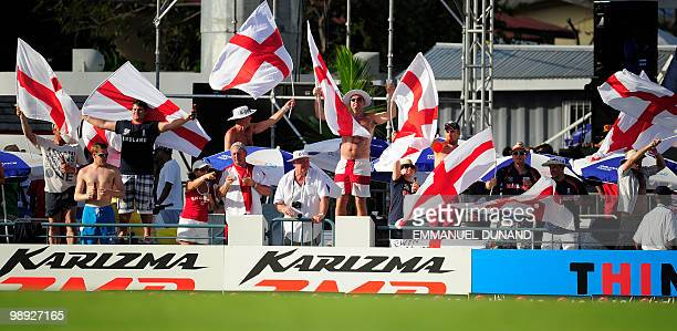 English cricket fans celebrate the fall of a South African wicket during the ICC World Twenty20 Super Eight match between England and South Africa at...