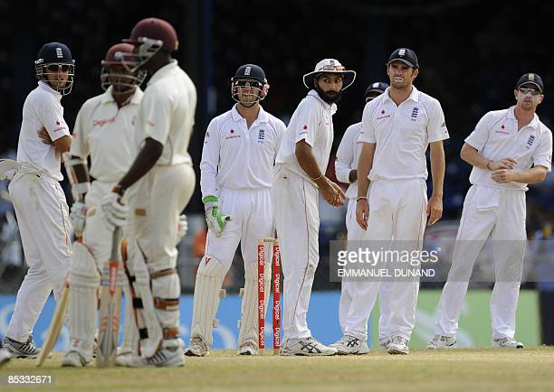 English cricket players look at West Indies batsmen Shivnarine Chanderpaul and Ryan Hinds, during the fifth and final day of the last test match in a...