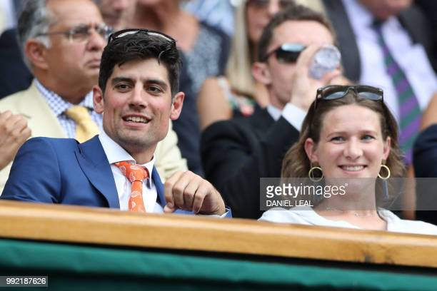 English cricketer Alastair Cook and wife Alice watch Spain's Rafael Nadal play Kazakhstan's Mikhail Kukushkin in their men's singles second round...
