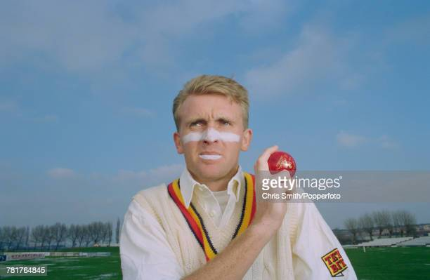 English cricketer Dominic Cork of England and Derbyshire posed holding a cricket ball circa 1995