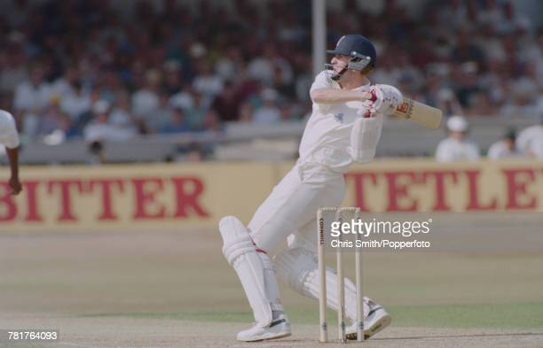 English cricketer Dominic Cork of the England cricket team pictured in action batting for England against West Indies during the 5th Test Match at...