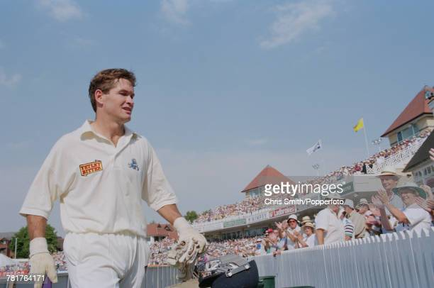 English cricketer Graeme Hick of the England cricket team walks off the field after batting for England against West Indies during the 5th Test Match...