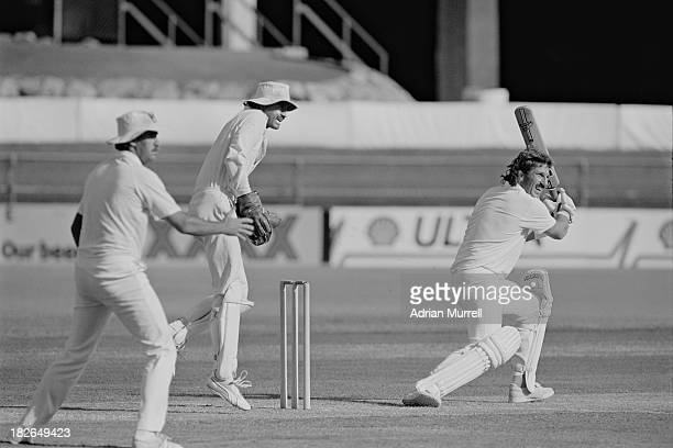 English cricketer Ian Botham batting for Queensland against South Australia in a Sheffield Shield match in Brisbane January 1988
