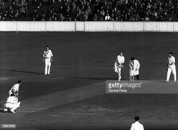 English cricketer Jim Laker bowling during a match between England and South Africa at the Oval
