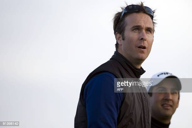 English cricketer Michael Vaughan and playing partner India's Shiv Kapur walk during the third round of the Alfred Dunhill Golf Championship at...