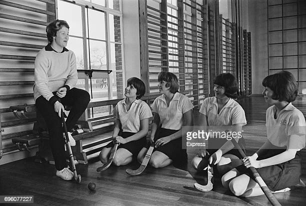 English cricketer Rachael Heyhoe with puplils in a hockey class during her tenure as a physical education teacher at Wolverhampton Grammar School...