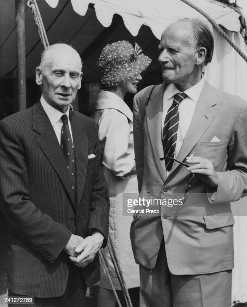 English cricketer Sir Jack Hobbs and writer Stephen Potter watching a cricket match between the National Book League and Authors teams Vincent Square...