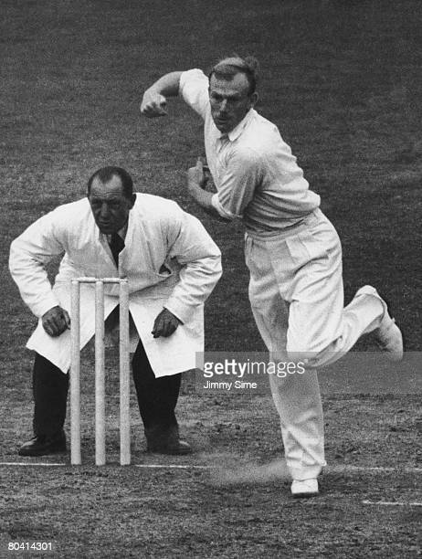 English cricketer Tony Lock bowls for Surrey at the Oval 1952