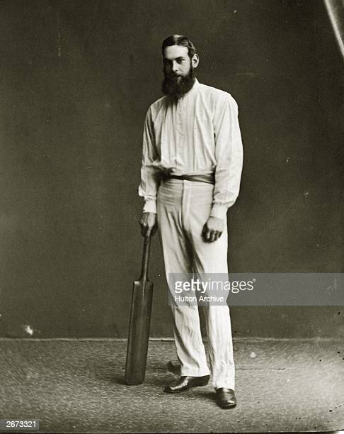 English cricketer W G Grace with a cricket bat.