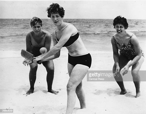 English cricketers Rachel HeyhoeFlint Edna Barker and Audrey Disbury practising on Perth beach during their tour of Australia