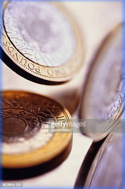 english currency: two pound coins, close-up - small group of objects stock pictures, royalty-free photos & images