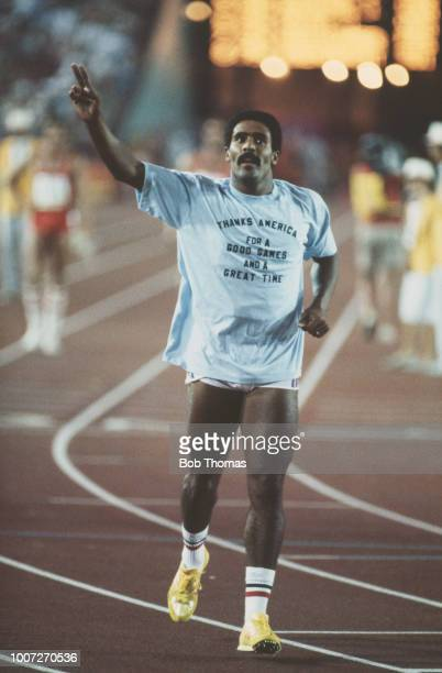 English decathlete Daley Thompson of the Great Britain team salutes the crowd after crossing the finish line in 14th place in the 1500 metres race...