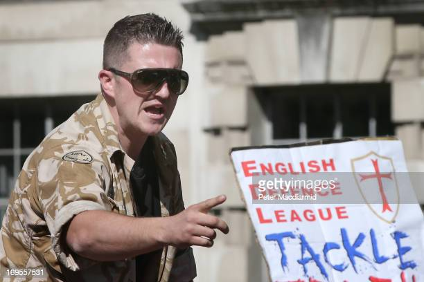 English Defence League leader Tommy Robinson speaks to supporters during a rally outside Downing Street on May 27 2013 in London England The EDL are...