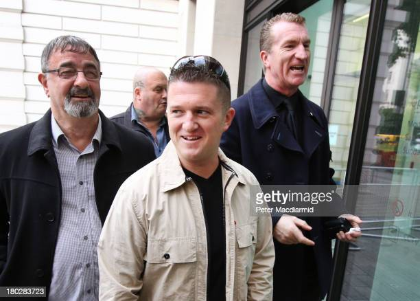 English Defence League leaders Tommy Robinson and Kevin Carroll arrive at Westminster Magistrates Court on September 11 2013 in London England They...