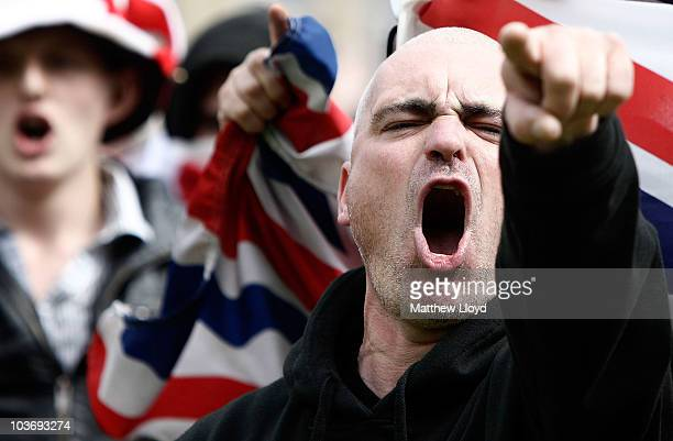 English Defence League supporters chant during a demonstration in the city centre on August 27 2010 in Bradford England Bradford City is bracing...