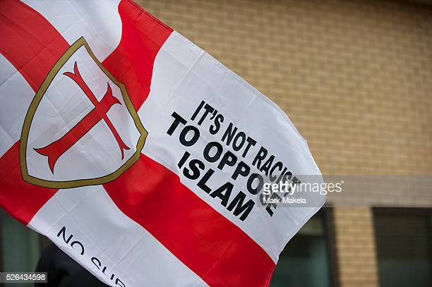 English Defence League supporters gather in support of leader Tommy Robinson also known as Stephen Lennon outside the West London Magistrates court...