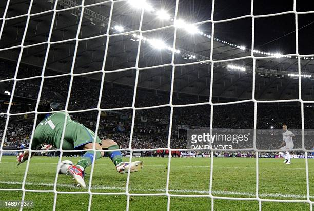 English defender Ashley Cole has a penalty saved by Italian goalkeeper Gianluigi Buffon during the penalty shoot out at the end of the Euro 2012...