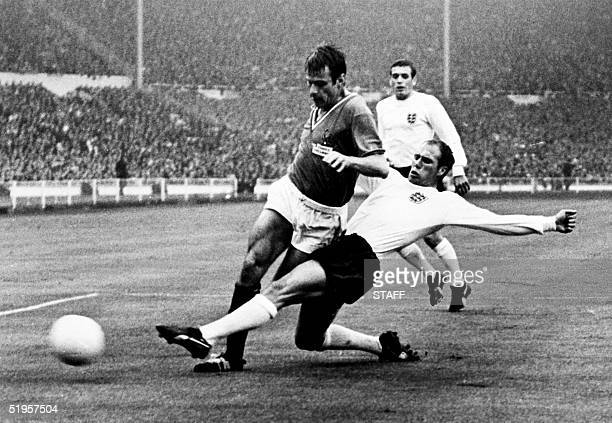 English defender Ray Wilson kicks the ball away from French forward Philippe Gondet 20 July 1966 at Wembley stadium in London during the World Cup...