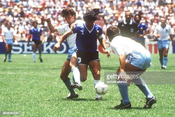 English defenders Terry Fenwick and Kenny Sansom try to stop Argentinian ace midfielder and goalgetter Diego Maradona On the way to the title the...