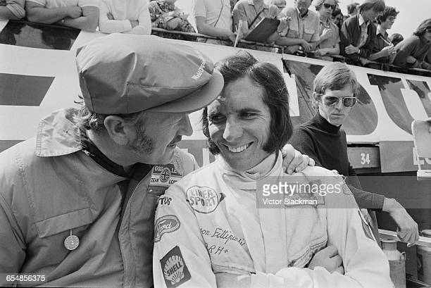 English design engineer Colin Chapman and Brazilian racing driver Emerson Fittipaldi during practice at Silverstone, UK, 1971.
