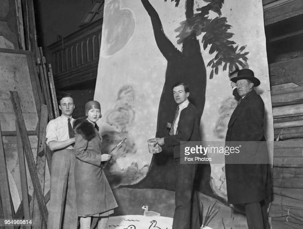 English designer Cecil Beaton and writer Osbert Sitwell painting a theatre backdrop May 1928